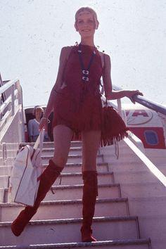 August 21, 1967: Twiggy wearing a fringe short skirt in London
