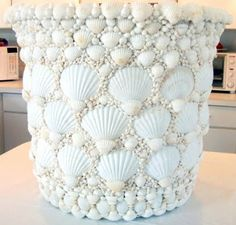 Shell Flowerpot Check out oceanofferings.com!  Now that's really pretty...add a bit of glitter?  Nice :-)