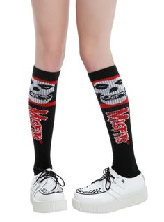 Black knee-high socks with red and white Misfits designs.