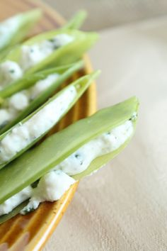 Herb & Cheese Stuffed Snap Peas (or Snow Peas) - these look delicious!