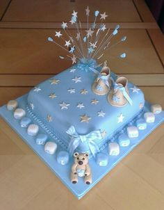 Christening cake specifics were cream beige and blue. Stars bootees and blocks