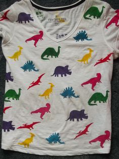 I made a new t-shirt as well, woooo Dinosaurs! I'm really happy with this one, but every time I wear it I keep seeing space that need filling with dinosaurs … blagh 100 Day Of School Project, 100 Days Of School, School Fun, School Projects, School Ideas, 100 Day Shirt Ideas, Diy Birthday Shirt, 100 Day Celebration, Vinyl Shirts