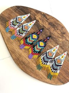 -Its absolute hand stitched earrings made with Japanese glass beads. Earrings Photo, Beaded Earrings, Photo Layers, Triangle Earrings, Mosaic Art, Beautiful Earrings, Hand Stitching, Beadwork, Hooks