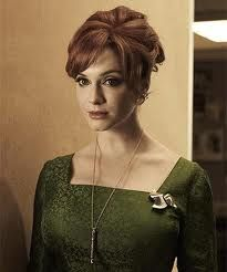 this combination of green dress and red hair is stunning!!!