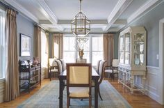 Coffered ceiling, wainscoting, and pair of oversized lanterns over the table Upholstered Dining Chairs, Dining Room Furniture, Slate Fireplace, Contemporary Light Fixtures, Traditional Dining Rooms, Beautiful Dining Rooms, Dining Room Lighting, Wainscoting, Dining Room Design