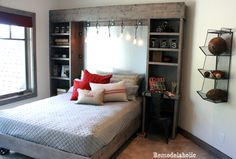 Love the idea of a 'built in' around the bed and how one of the nightstands functions as a desk!