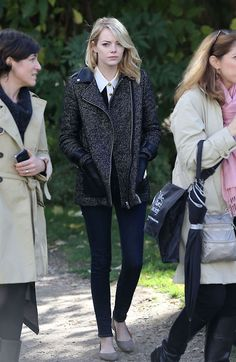 Emma Stone wearing a jacket by Maje at Paris Fashion Week.