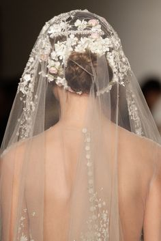 A model walks the runway during the Reem Acra Fall 2015 Bridal Collection show at the Reem Acra Boutique on October 10, 2014 in New York City.
