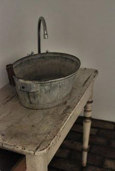Could be fun to make bathroom in attic very basic with a galvanized bucket sink on an old table. Rustic chic decor in the most underdone way. (Not the sink but yes to the table! Primitive Bathrooms, Rustic Bathrooms, Modern Bathrooms Interior, Contemporary Bathroom Designs, Modern Bathroom Decor, Small Bathrooms, Modern Bathroom Design, Bathroom Interior Design, Bucket Sink