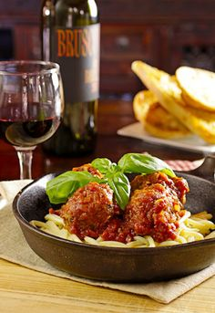 Grandma Maroni's 100 year old recipe for Meatballs for Diners, Drive-Ins and Dives      Mike Maroni's Grandma Maroni's Meatballs (100-year-old recipe) Slightly adapted from Bobby Flay's Throwdown Serves 4