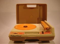 I had this Fisher-Price turntable as a kid. I saw one in the window of a record store today and am very tempted to buy one for my son so he can listen to my few remaining K-Tel albums.