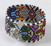 Peyote stitch bracelet: The Illusion by Julie Ann Smith. Free peyote stitch beading project from Beading Daily!  http://www.beadingdaily.com