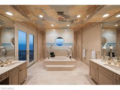 7409 Bay Colony Dr, Naples, FL 34108 | Shower with a window on the world | Gulf view from the bathroom | The Strand at Bay Colony | Naples Modern Homes for Sale