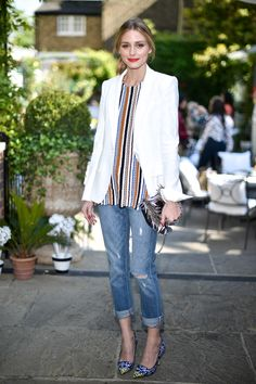 Olivia Palermo wore a crisp white blazer and boyfriend jeans to the Jimmy Choo tea party to celebrate the brand's new collaboration with Rafael Mantesso | Harper's Bazaar