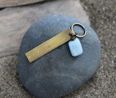 This keychain is inspired by my Five Deep Breaths practice, which invites you to pause and take five deep breaths with intention. As you breathe, relax your shoulders, notice how your breath moves in your body, try to let go of anything pulling on you, feel the space you create inside you, and let your mind rest in this space.