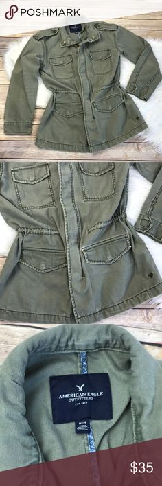 """American Eagle Women's Cargo Jacket, Army Green American Eagle Women's Cargo Jacket. Cinch waist, zipper and button closure. Multiple snap button pockets. Size Medium. Length is approximately 28"""", width is approximately 18"""" armpit to armpit. Sleeve length is approximately 20"""". No stains or tears, light wear. Cute jacket with feminine flair! American Eagle Outfitters Jackets & Coats"""