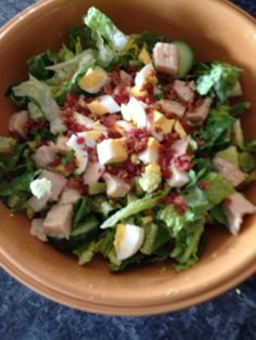 330 calorie lunch salad - boiled egg, bacon bits, grilled chicken, lettuce, cucumber, tomato, light Caesar dressing