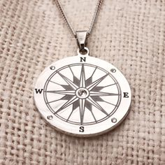 Our Engravable Stainless Steel Compass Pendant is the perfect gift for the explorer in your life.