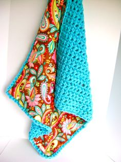 Fabric lined crochet blanket.
