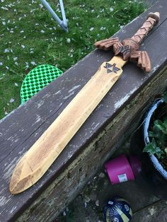 A wooden sword I made for a friends son based on The Legend of Zelda Skyward Sword. Made from recycled wood.