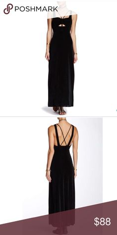 "Free People Black Jersey Maxi Dress Strappy front with cutouts, cross back straps, Maxi Dress. Heavy Jersey fabric, fully lined. I'm 5'3"" and it falls just above the floor for me barefoot. Super comfortable and very sexy. Perfect for a no effort way to look amazing!!! Fully lined. 95% Acetate, 5% spandex. Still in plastic packaging. Free People Dresses Maxi"
