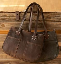 My favorite CCW purse. Made from Bison. The leather is heavenly! Lockable compartment with holster. http://www.thewellarmedwoman.com/apps/store/default.asp?view=profile&itemid=39164