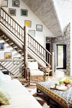Wood stairwell in cabin with small gallery wall lining stairs