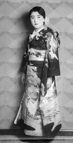 """Young woman in furisode. Embossing says """"Aoyama Studio. Aoyama, Tokyo.. Probably dates to 1920's, Japan. Image via Japan-esque on Flickr"""
