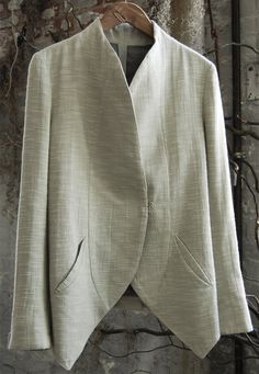 Inspiration  -Crescent shaped Welt Pockets. - I would like this so much more if the jacket wasn't so boxy