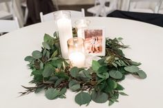 Romantic wedding reception centerpiece - gorgeous greenery encompassing candles and photos of the newly weds Engagement Party Centerpieces, Photo Centerpieces, Wedding Reception Centerpieces, Floral Centerpieces, Dream Wedding, Wedding Things, Wedding Stuff, Wedding Colors, Wedding Flowers
