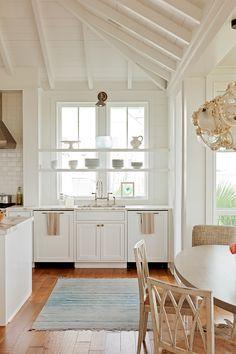 Shelves across kitchen windows South Carolina Beach House with Coastal Interiors