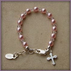 Made in America. Bella Sterling Silver Childrens Girls Bracelet Jewelry Beautiful keepsake sterling silver bracelet with pink Czech pearls and crystals accented with a darling silver cross - perfect for christenings and communion with a touch of pink! Size Large 6-13 Years. Perfect for Christmas, First Communion, Easter, Graduation, Sunday Dress, Christening or Birthday. Hail Mary Gifts. $32.00. Childrens Jewelry