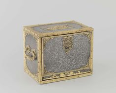 Casket. Anonymous, c. 1560 - c. 1600. H 21.0 cm × w 28.8 cm × d 33.8 cm. Place: Augsburg or Neurenberg. This casket exudes an air of luxury in every way. Its sides are faced with steel plates ornamented with a pattern of strapwork and foliage scrolls. The plates are set within finely worked gilt bronze mounts. The front opens, revealing nine little drawers of various sizes that were probably meant to hold jewellery or other small precious objects. -Rijksmuseum Amsterdam-