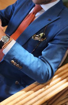Did someone say blue blazer..but not the traditional blue blazer..something a little lighter, perhaps, accessorized with a white shirt and orange tie and orange bracelet, a nice classic watch, and sunglasses on a string plus the pocket square, of course. Does this fit the bill? Certainly.