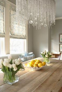 Martha O'Hara Interiors Gorgeous dining room with gray walls paint color, ivory & blue damask roman shades, reclaimed wood trestle dining table, gray settee and bubbles crystal chandelier.