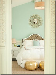 Love the wall color for a bedroom. And the headboard. And the side table...