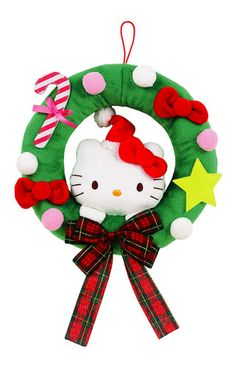 """Decorate your door with this lovely Hello Kitty Christmas Wreath. This green wreath features Hello Kitty in a red Santa head peering her way through to friends and visitors. The green wreath is also decked out with Hello Kitty's bow and lovely pink candy cane. See safety message.    - 10"""" x 2"""" x 10""""   - choking hazard-small parts"""