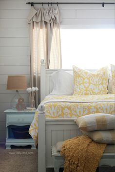 A beautiful and bright summer bedroom with Crane and Canopy Montgomery yellow duvet.