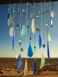 This sea glass windchime consists of 21 silver link strands- 17 with sea glass and 4 with turquoise colored crackle marbles. The sea glass colors Sea Glass Crafts, Sea Glass Art, Sea Glass Jewelry, Mosaic Glass, Fused Glass, Stained Glass, Blowin' In The Wind, Sea Glass Colors, Glass Wind Chimes