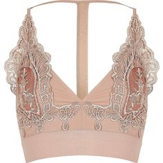 River Island Petite blush pink lace T-back bralette (€41) ❤ liked on Polyvore featuring tops, t-shirts, crop top, underwear, bralette, lingerie, pink, crop tops / bralets, women and pink tee