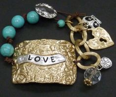 Love Stamped Charm Bracelet perfect accessory for that stylish gal wanting to make a statement $25.99