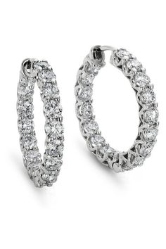 In each earring, seventeen brilliant diamonds are prong-set in 18k white gold for a continuous band of brilliance around each hoop.