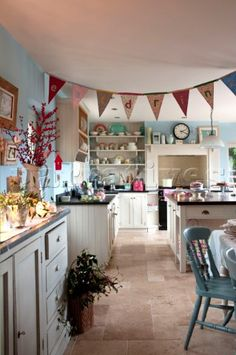 Google Image Result for http://www.narratives.co.uk/ImageThumbs/PE086_56/3/PE086_56_Bunting_hangs_in_pastel_blue_country_style_kitchen.jpg