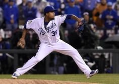 Kansas City Royals starting pitcher Edinson Volquez throws in the first inning during game one of the World Series on Tuesday, October 27, 2015 at Kauffman Stadium in Kansas City, Mo.