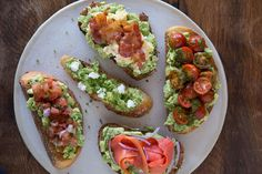 Five different ways to make the best meal ever - avocado toast! Including smoked salmon, goat cheese, tomato basil, bacon and egg and pico de gallo.