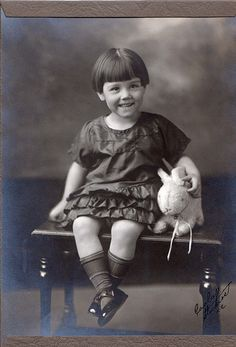 antique photo of girl with bunny - I don't think of Nana as being an antique, but I have seen several pictures of her, as a child, with a similar haircut
