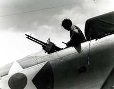 Wake Island Raid, 24 February Crewman readies rear-cockpit Cal MG. Mount on a Douglas Dauntless prior to the launching of air strikes against Wake. View taken on board USS Enterprise (CV National Archives photograph, Royal Navy, Us Navy, Uss Enterprise Cv 6, Wake Island, Voice Of America, Flying Boat, National Archives, Luftwaffe, World War Two