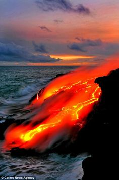 Daredevil photographers capture the drama of searing-hot lava crashing into the seas off Hawaii