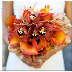 A orange orchid and lily combo are perfect for a summer wedding bouquet!