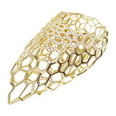 'Skein' by Zaha Hadid for Caspita, 18k yellow gold and diamonds.